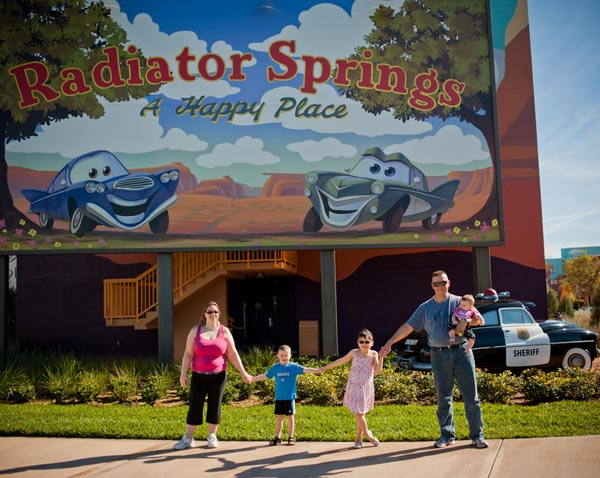 Family at Radiator Springs sign